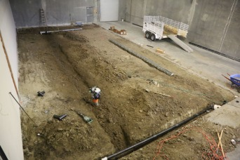 Here's a view from above! We now have fully graded dirt, the floors all clean and three trench drains in place.