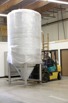 Placing our largest tank, the 60bbl fermentor...it only weighed in at 3500lbs.